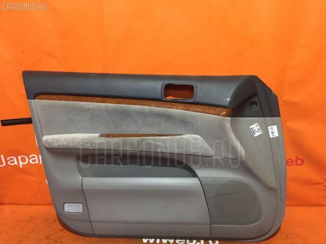 Обшивка двери на Toyota Mark II GX110