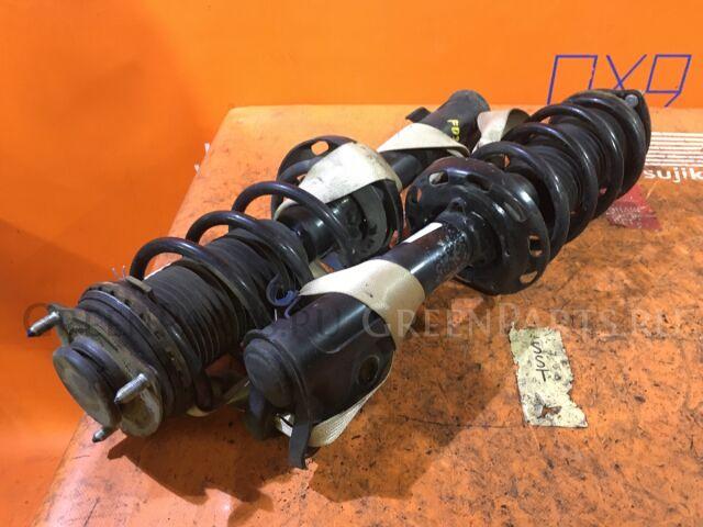 Стойка амортизатора на Honda Civic FD3 LDA