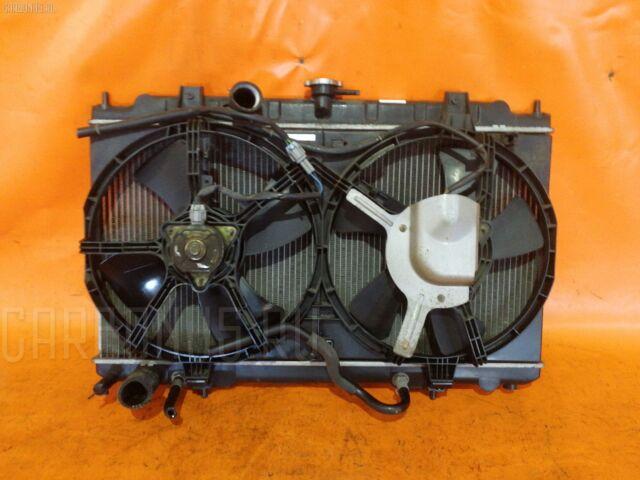Радиатор двигателя на Nissan Primera TNP12 QR20DE