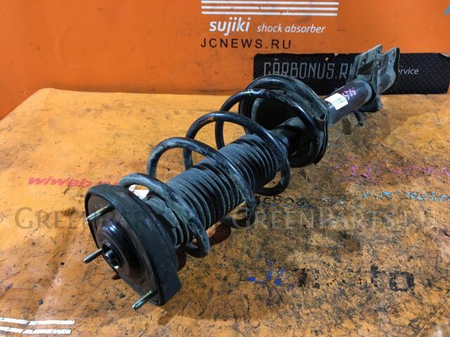 Стойка амортизатора на Subaru Forester SG5