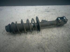 Стойка амортизатора на Toyota Vitz NCP95 2NZ-FE
