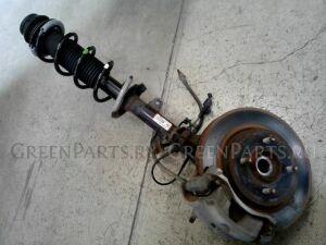 Стойка амортизатора на Nissan Note E12 HR12DDR