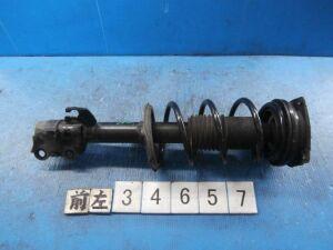 Стойка амортизатора на Nissan Tiida C11 HR15