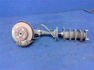 Стойка амортизатора на Toyota Platz SCP11 1SZFE