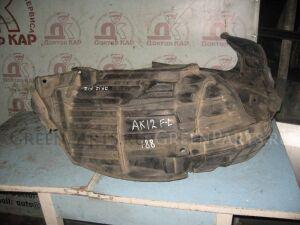 Подкрылок на Nissan March AK12