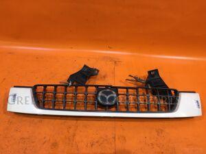 Решетка радиатора на Mazda Demio DW3W